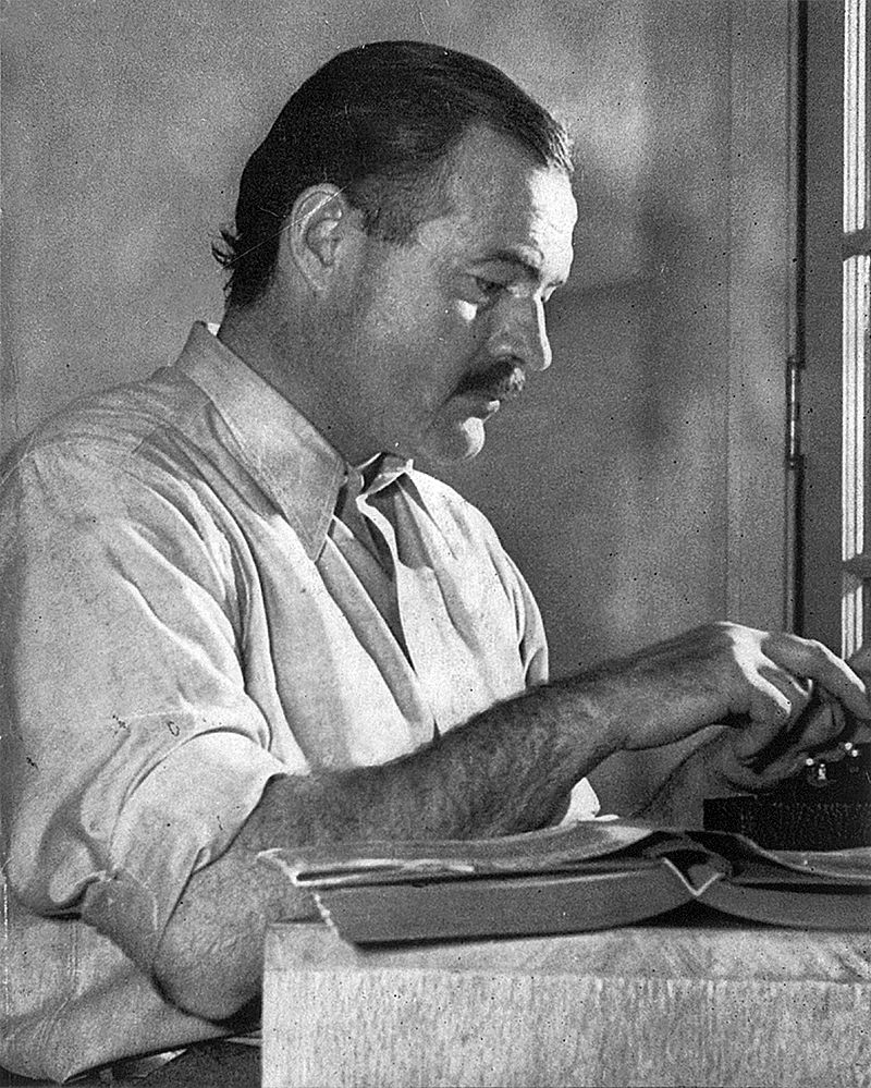 "Hemingway posing for a dust jacket photo by Lloyd Arnold for the first edition of ""For Whom the Bell Tolls"", at the Sun Valley Lodge, Idaho, late 1939. This photo is now proudly displayed on the walls of the Lodge and was prominent there when I visited in March 2016"